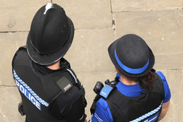 Two police officers photographed from above