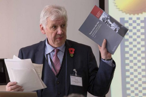 Image of Lord Bew holding a copy of CSPL report 'tone from the top'