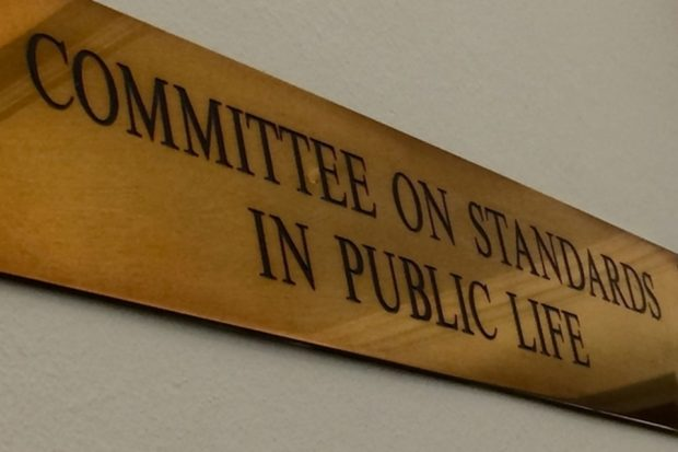 Image of bronze plate with the wording 'committee on standards in public life'