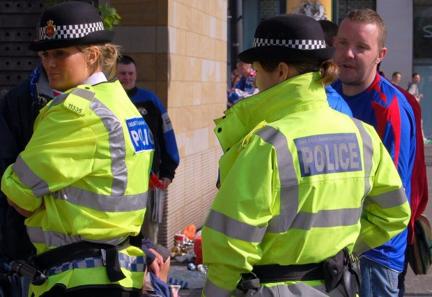 An image of two police officers and a member of the public