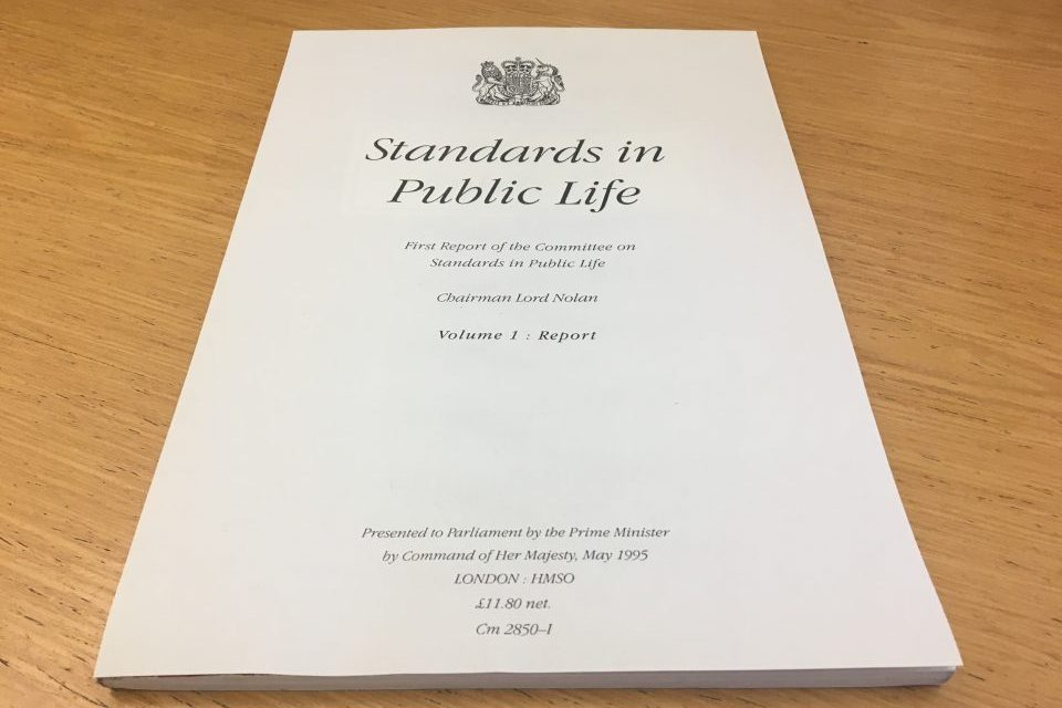 A4 front cover of CSPL's first report, stating: 'Standards in Public Life First Report of the Committee on Standards in Public Life Chairman Lord Nolan COlume 1: Report'