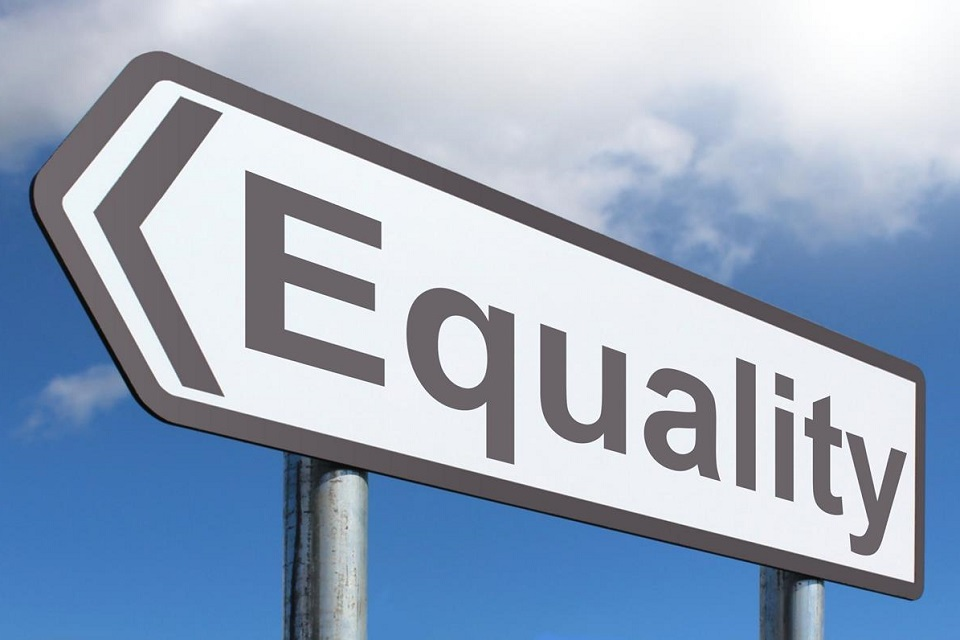 A road sign pointing in the direction of equality