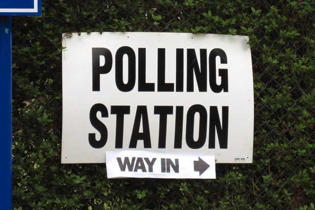 "Sign saying ""polling station, way in"""